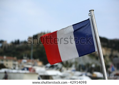 french flag on a boat fluttering in the wind - stock photo