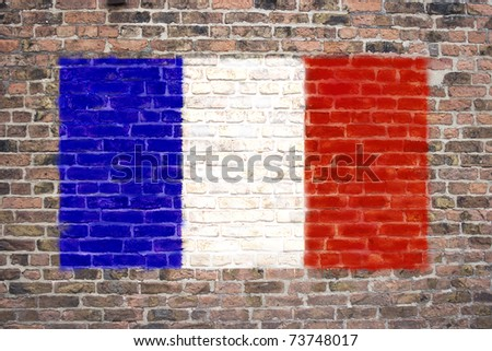 French flag sprayed on brick wall - stock photo