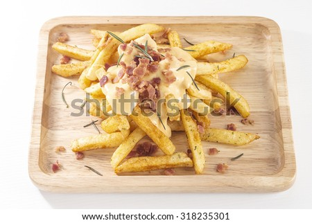 French Fried Melted Cheddar Cheese with Crispy Bacon and Rosemary on Wooden Plate, White Background - stock photo