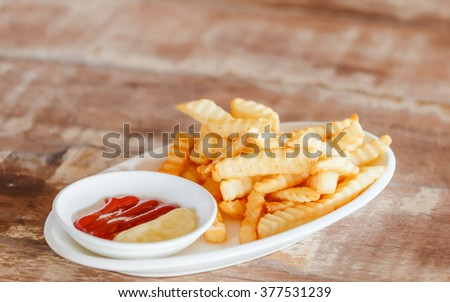 french fried on the dish - stock photo
