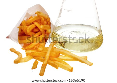 french fries and beaker full of liquid trans fat isolated on white background- could also be GMO concept