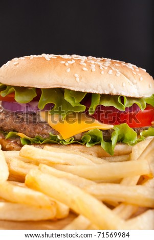 french fries and big cheeseburger - stock photo