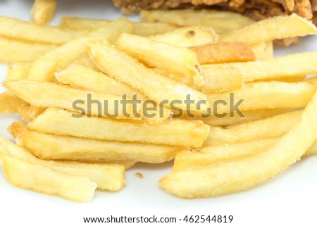 French fries and Breaded chicken fingers on white dish.
