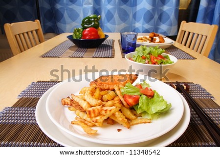 French fries and chicken legs on the plate with garlic sauce
