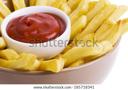 French fries and ketchup isolated on white background.