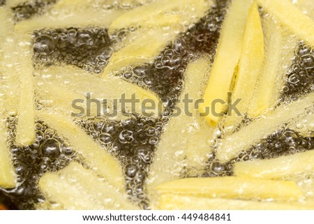 French fries fried in a pan - stock photo