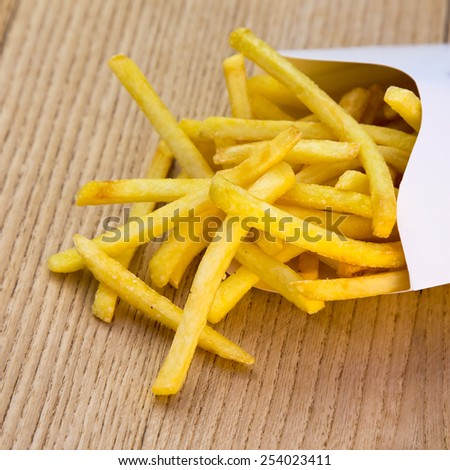 French fries in a package of white cardboard - stock photo