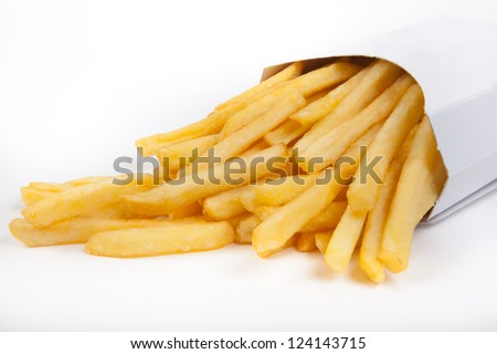 French fries in a paper wrapper - stock photo