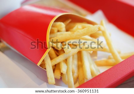 french fries in red carton pack - stock photo