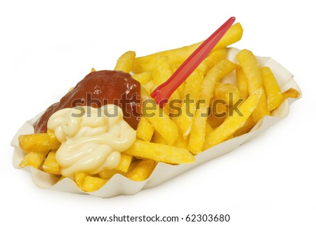 French fries on a paper plate on bright  background - stock photo
