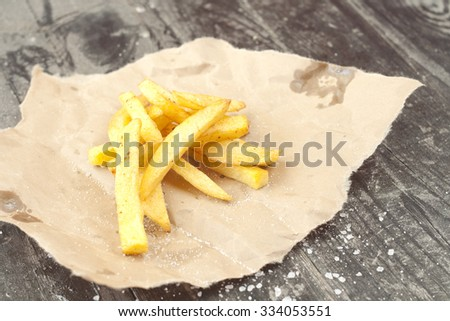 French fries on a wooden table