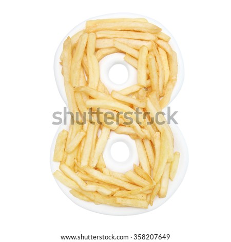 French fries on handmade number plate - stock photo
