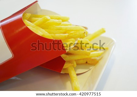 French fries on white background. - stock photo