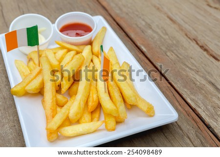 French fries on wood table - stock photo