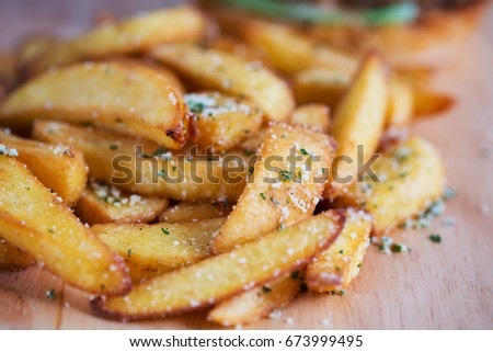 french fries on wooden board