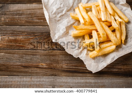 French fries on wooden table. - stock photo
