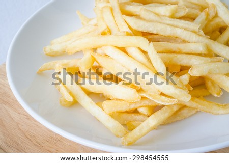 French fries or French-fried potatoes on a white dish.