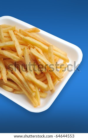 French fries potatoes on a blue background - stock photo