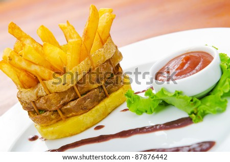 French fries served with ketchup - stock photo
