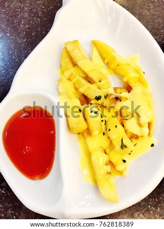 French fries sweet sauce on top with ketchup