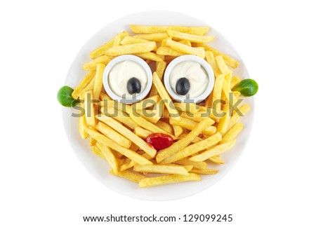 French fries with a funny face isolated on white - stock photo