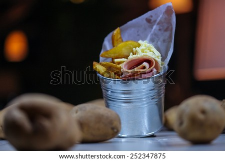 French fries with bacon - stock photo