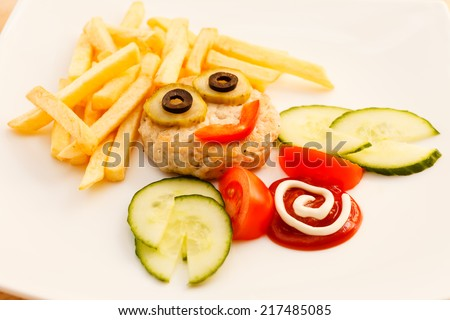 french fries with cutlet for kids menu - stock photo