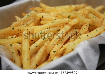 French Fries with Parsley Flakes - stock photo