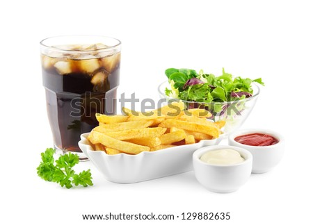 French fries with soda and a fresh lettuce salad - stock photo