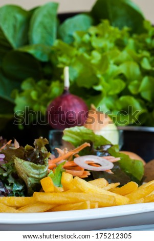 French Fries with vegetable salad on Green background