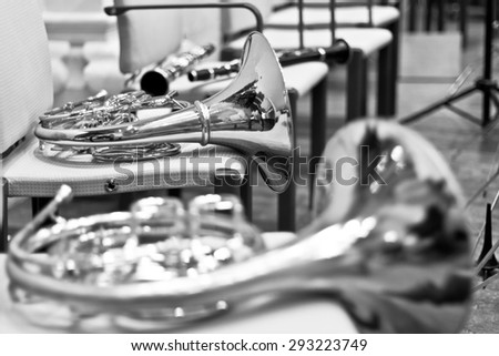 French horn in the concert hall. Wind instrument. French horn. Horn. Concert of classical music. Large Symphony Orchestra - stock photo