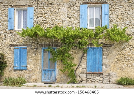 French house with blue shutter. Provence. - stock photo