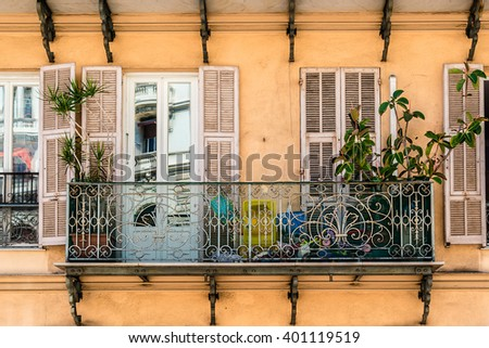 French house with traditional balconies and windows. Nice, France. - stock photo