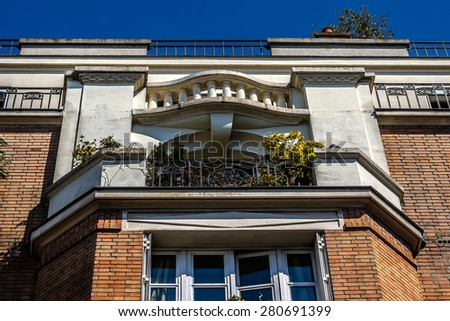 French house with traditional balconies and windows. Paris, France. - stock photo