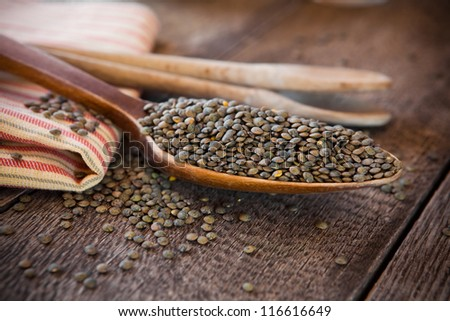 French lentils in a wooden spoon - stock photo