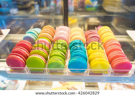 French macarons for sale on glass showcase in coffee shop, Shallow DOF