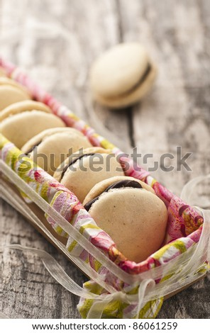 French macarons with dark chocolate filling - stock photo