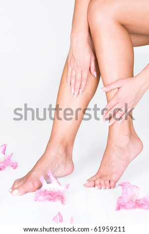 French manicure and pedicure with delicate flowers - stock photo
