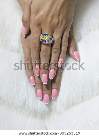 French manicure nails and chamomile flowers - stock photo