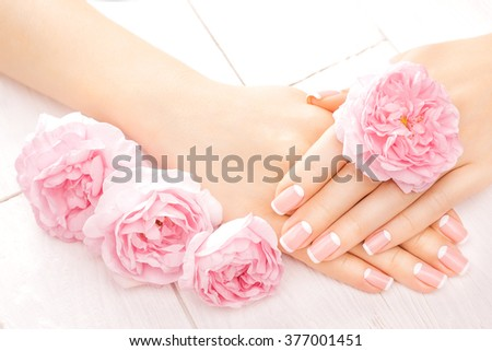 french manicure with rose flowers. spa - stock photo