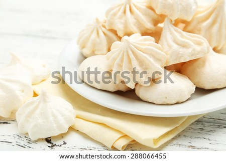French meringue cookies on white wooden background
