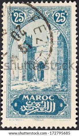 FRENCH MOROCCO - CIRCA 1923: A postage stamp printed in the Morocco shows Chellah or Sala Colonia complex of ancient Roman Mauretania Tingitana and medieval ruins near Rabat, circa 1923 - stock photo