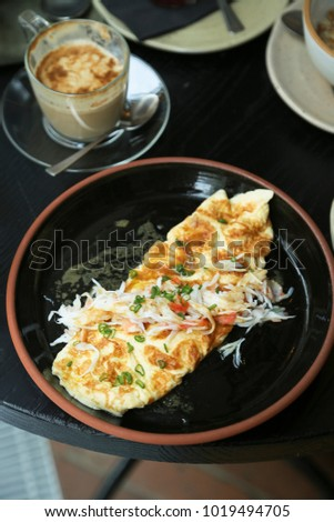French omelette with herbs and crab meat