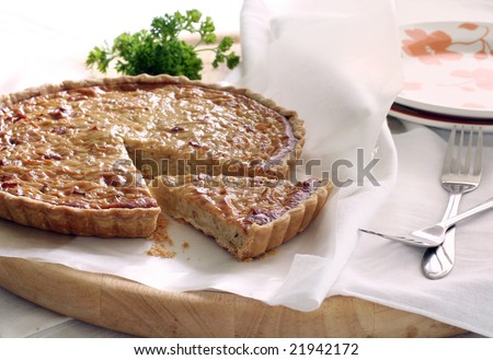 French onion quiche with a portion cut out - stock photo