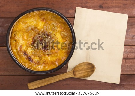 French onion soup in a ceramic bowl. - stock photo