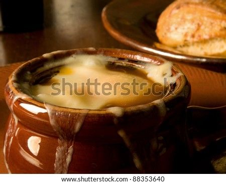 French onion soup, loaded with Gruyere and piping hot - stock photo