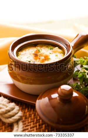 French onion soup with cheese and bread. Shallow depth of field