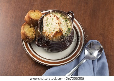 French onion soup with crispy gruyere cheese baked to perfection - stock photo