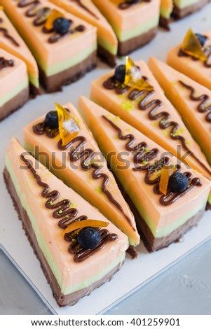 French pastry. Top view of pieces of fruit mousse cake. Shallow focus - stock photo