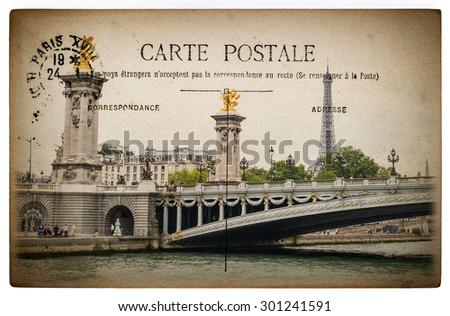 French postcard from Paris with landmark bridge Pont Alexandre III. Vintage paper background - stock photo